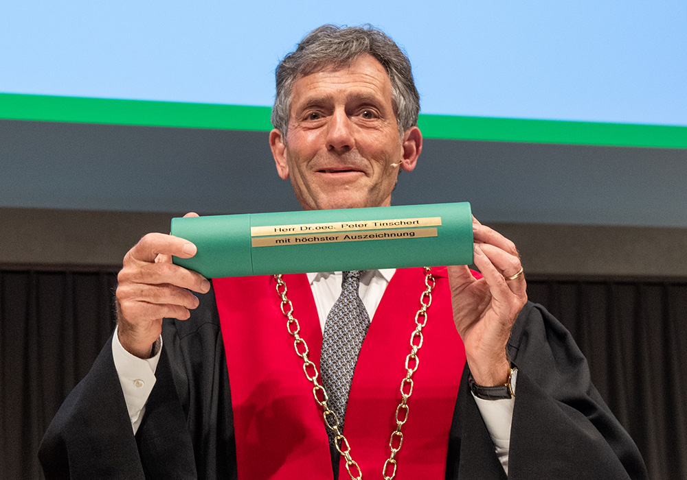 Prof Dr Bernhard Ehrenzeller, President of the University of St.Gallen, congratulated Peter virtually (see image below).